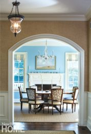 Perfect for dinner parties, the dining table expands to seat twelve; the antique chairs are a delicate counterpoint to the pedestal table.