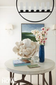 The entry presages the home's beachy vibe with its stunning piece of coral and a painting by Provincetown artist Anne Packard.