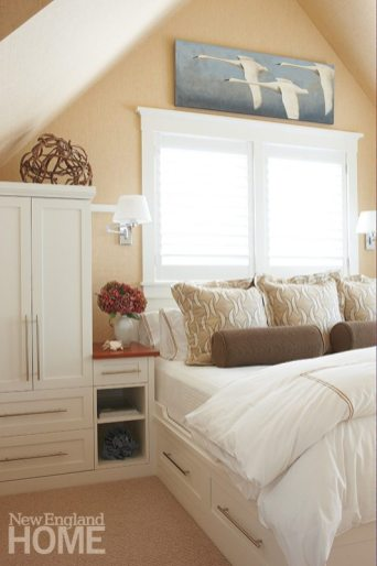 A second-floor bedroom with an efficient built-in bed and storage wears a Phillip Jeffries grasscloth on walls and ceiling.