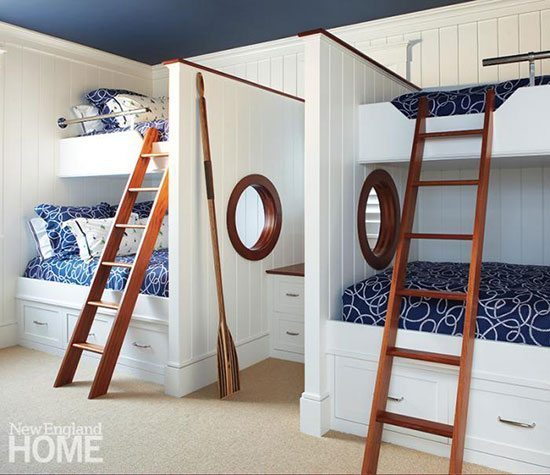 The children's bunk room has open portholes trimmed with mahogany and a ceiling painted Benjamin Moore's Newburyport Blue.