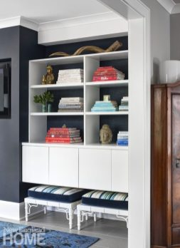 Built-ins offer storage and display in a sitting room.