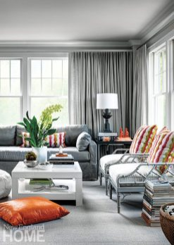 Vivacious tones of fuchsia, orange, and chartreuse add excitement to the soothing palette of gray and white in the media room.