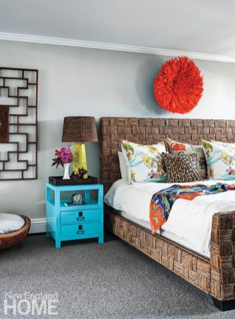 A Cameroonian juju hat and a raffia-wrapped bed give the master bedroom a tropical resort feel.