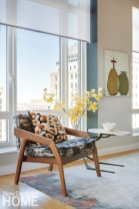 The Friday Lounge Chair by Zeitraum stands on an abstract, hand-knotted silk rug from Fort Street Studio.