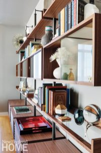 The clients' books and collections are displayed on the Ubiqua shelving system by Porada.