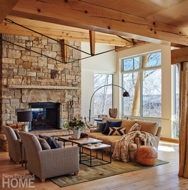 In the living room, wood, stone, and massive windows forge a true connection to the views.