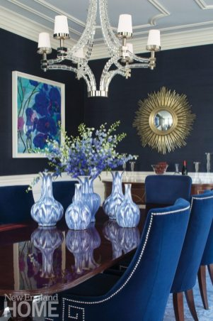 The husband's love of rich color is addressed in the dining room with its blue grasscloth walls and blue-velvet chairs.