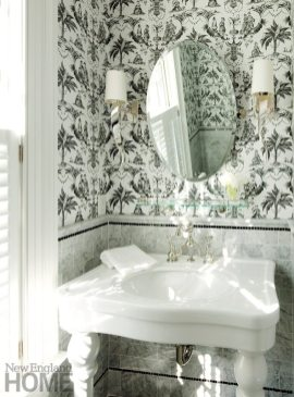 A black-and-white palette streamlines the compact powder room.
