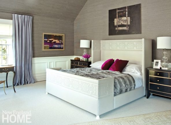 A smoky-colored Phillip Jeffries wallcovering and a soft Merida rug enhance the master bedroom's cocoon-like ambience.