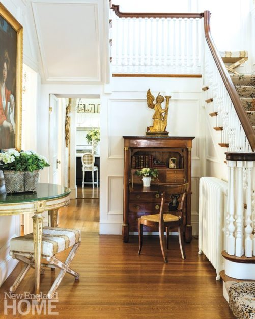 A winged angel designer Jackie Whalen discovered at David Neligan Antiques in Essex, Massachusetts, never fails to charm visitors. The Leopard Rose stair runner is by Stark.