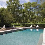 Six-foot hedges give the pool its privacy.