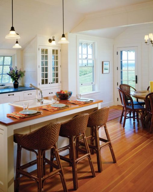 Reclaimed pine tops the kitchen island.