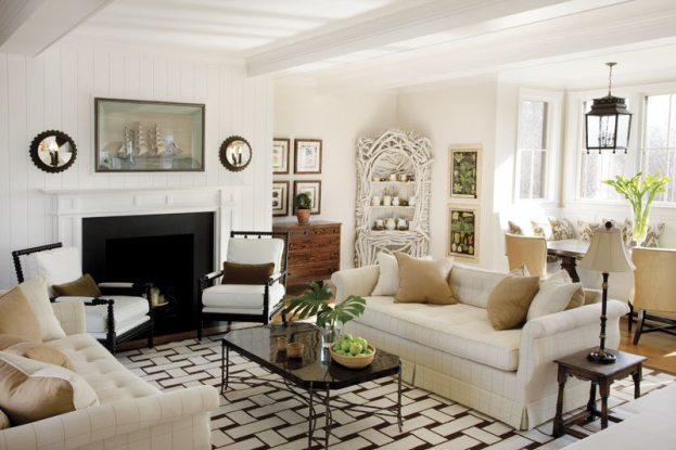 The neutral-toned living room is cozy yet chic with its tufted sofa, bobbin chairs and basketweave rug.