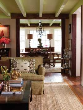 The open living room and dining room offer long vistas in the small cottage.