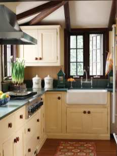 Low ceiling angles create interest in the L-shaped kitchen that connects the dining room with the conservatory.