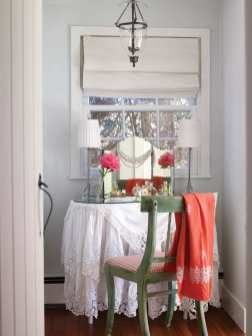 A lace-draped dressing table in the master suite holds a vintage mirror.