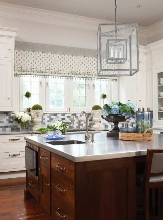 Four shades of marble enrich the kitchen backsplash.