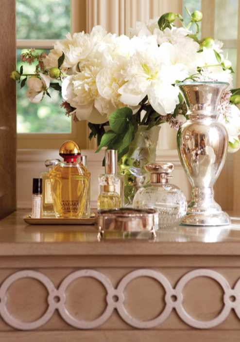 Mercury glass, silver and fresh flowers spell luxury.