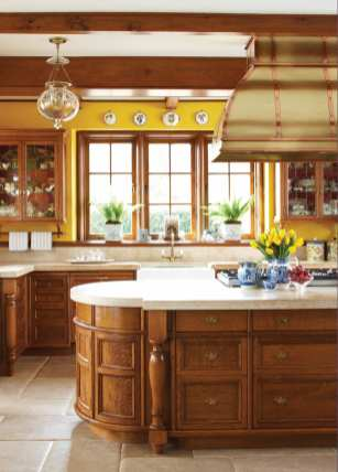 French limestone floors and counters and oak woodwork give the kitchen a country ambience.