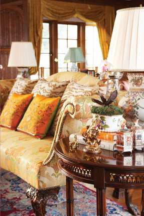 Wadia replaced the paneling in the living room and removed wooden ceiling beams to give the room a less rustic look.
