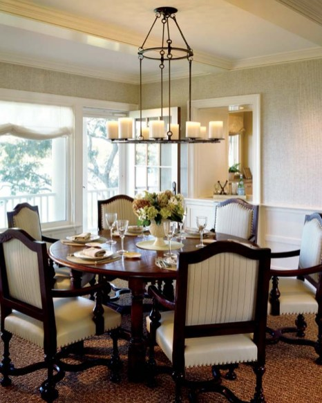 A Holly Hunt chandelier and custom chairs elevate the dining area.