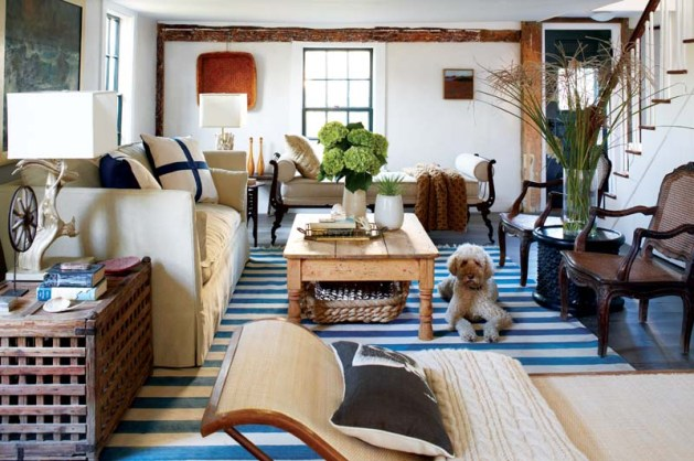 Chelsea, a standard poodle, relaxes on the Odegard dhurrie rug that helps give the family room its relaxed, beachy feel.