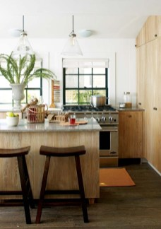 Kolb used a piece of driftwood as inspiration for the finish on the kitchen cabinets.