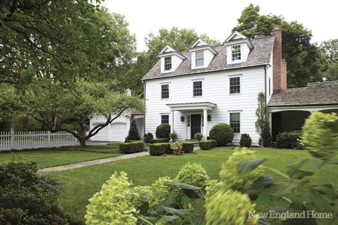 Boxwoods frame the classic colonial.