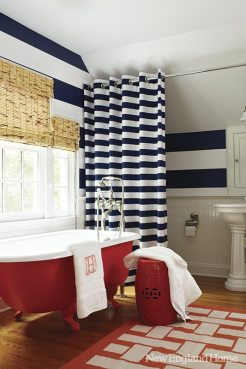A bold canvas curtain separates the tub and toilet in the third-floor bath.