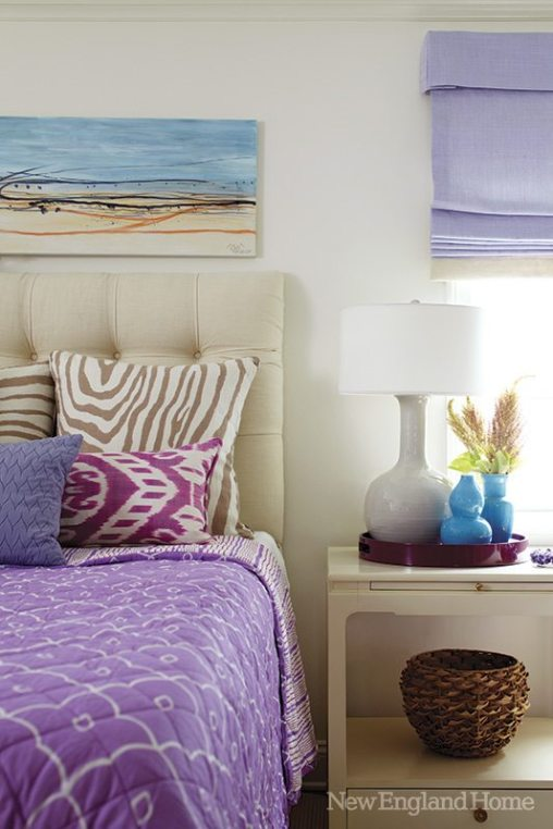 The master bedroom is outfitted in the wife's favorite shades of lavender.