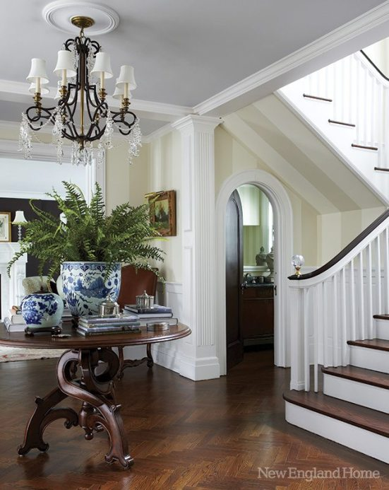 Era-appropriate moldings and paneling were reintroduced in the entry and throughout.