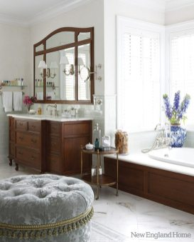 The posh master bath was inspired by the French Empire style.
