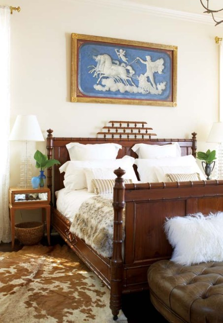 Modern mixes with antiques and animal prints in the master bedroom.
