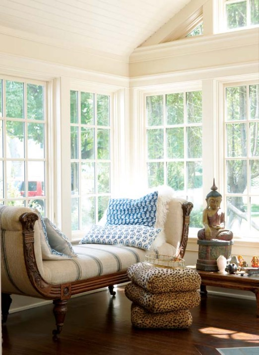 The Mergys added the sunroom addition for a sitting area bathed in natural light in contrast to the stained-glass filtered light in the living room.