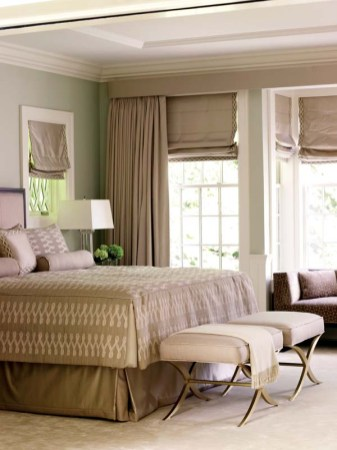 A second sitting area is tucked into a niche near the bed.