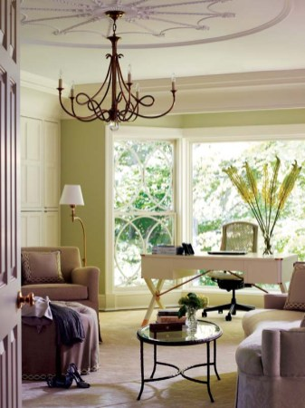 Natural light spills into the master bedroom's sitting area. The window detail is repeated on the ceiling and in the chandelier, coffee table and fabric trim.