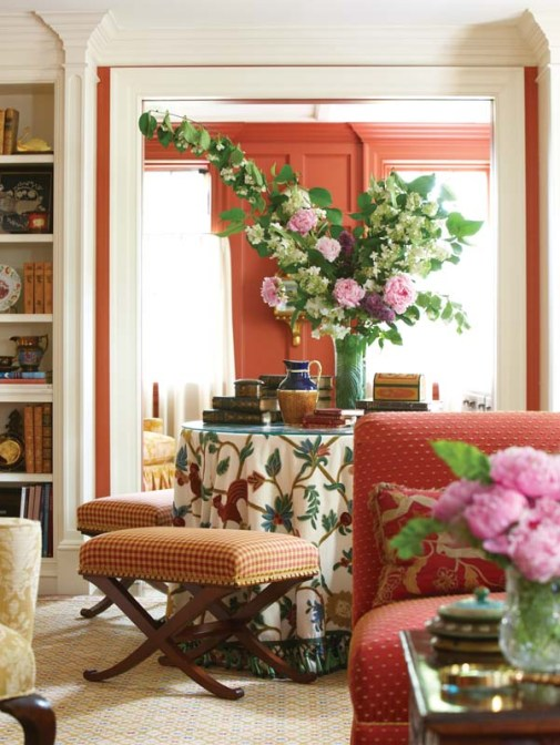 Gingham, dots and florals both vivid and subdued mingle in the living room.