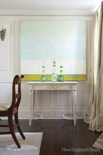 A painting by Sarah Hinckley makes a statement in the dining room.