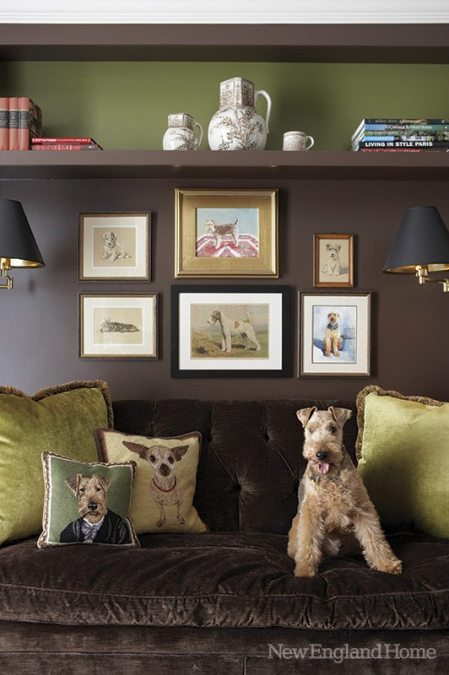 George, a Welsh terrier, relaxes in the study below a portrait of himself by Susan Randall.
