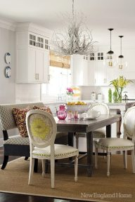 Indoor-outdoor fabric on the bench and faux crocodile on the chair seats make it easy to clean the breakfast room after feeding three children under the age of four.