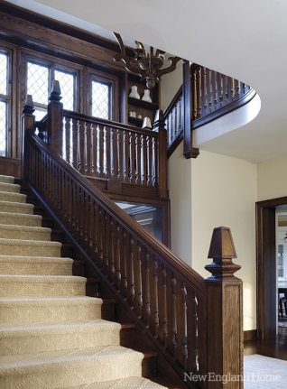 The oak woodwork of the graceful staircase was restored to its original luster.