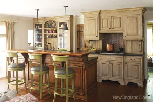 Decorative painter Suzanne Bellehumeur gave the kitchen cabinets an aged French country look with multiple layers of paint and a seal of tinted furniture wax.