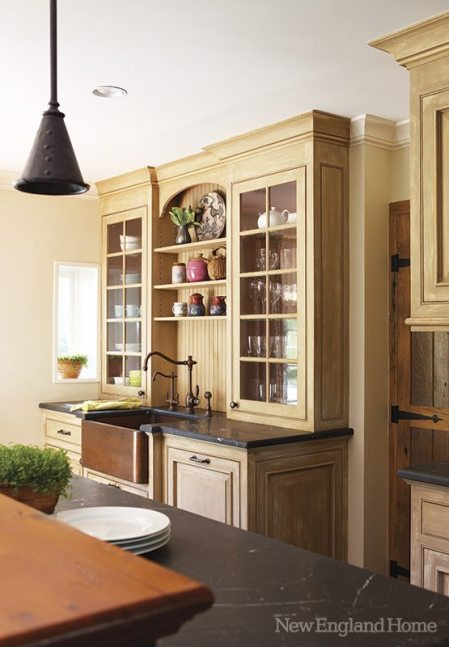 The cabinets display both everyday dishes and ceramic art.