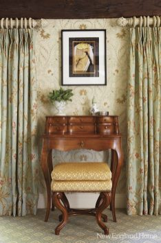 An antique desk doubles as a dressing table.