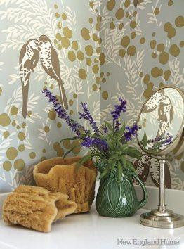 Romo'€™s Mirabel wallpaper dresses the charming bathroom.