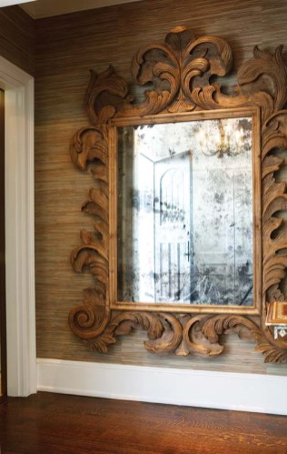 A faux-antique mirror is a focal point in the foyer.