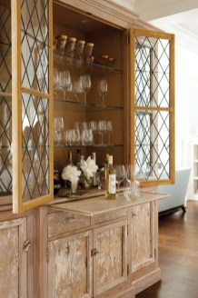 The wet bar was crafted from old barn floorboards and a set of Victorian leaded-glass windows.