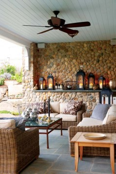 Stone walls give the porch its cozy feel.
