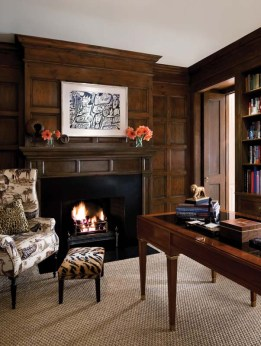 The library'€™s paneled walls are knotty pine faux-painted to blend with the rest of the house.