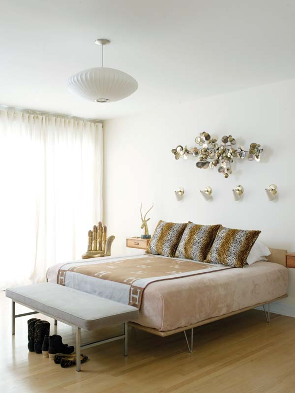 Neutral tones in the bedroom break from the bolder colors in the rest of the house.